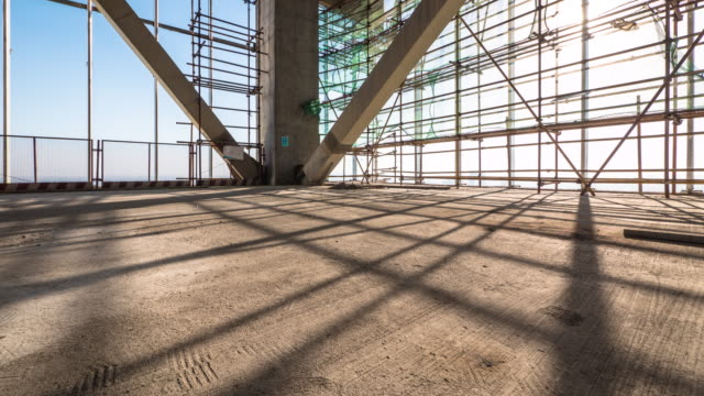 shadow of steel frame of new constructions site. timelapse 4k