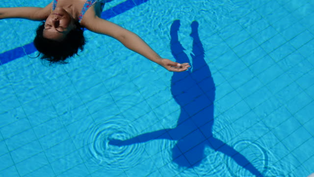 Shadow of Woman Floating on the Water