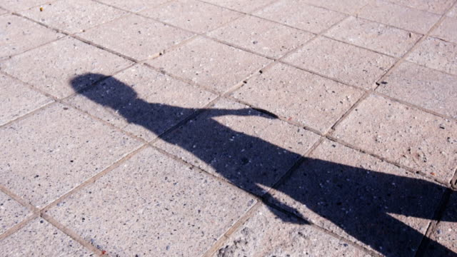 Shadow of woman walking