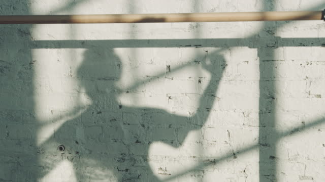 shadow of young ballet dancer on wall in studio - ballet dancing stock videos & royalty-free footage
