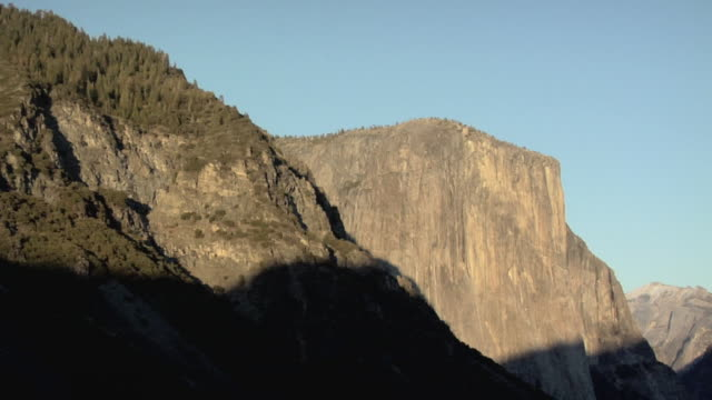 t/l ms shadow on rock formations, yosemite national park, california, usa - yosemite national park stock videos and b-roll footage