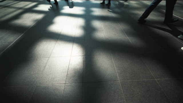 shadow walker, walking people in train station corridor - diminishing perspective stock videos & royalty-free footage