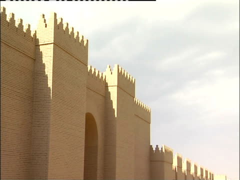 shadows cover a stone parapet wall. - babylon stock videos and b-roll footage