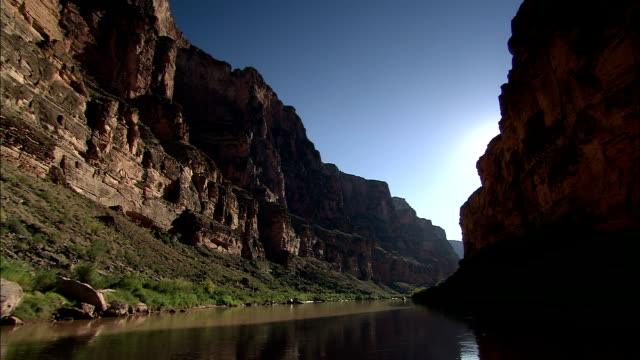 shadows darken a cliff in a grand canyon gorge. - river colorado stock videos & royalty-free footage