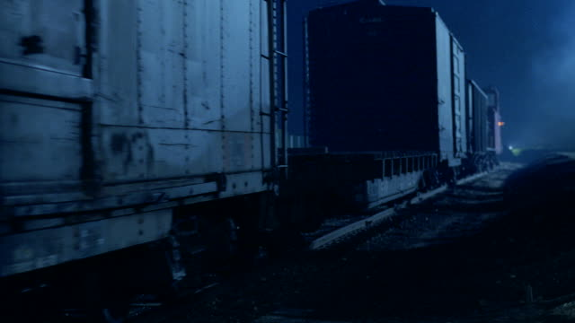 shadows fall across passing boxcars. - c119gs点の映像素材/bロール