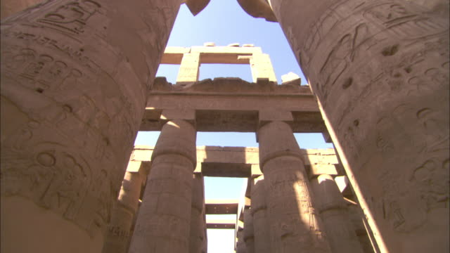 Shadows fall across the columns of Karnak Temple in Egypt.