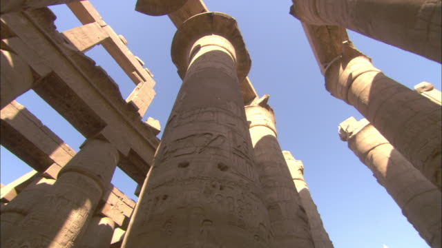 shadows fall across the columns of karnak temple in egypt. - temples of karnak stock videos and b-roll footage