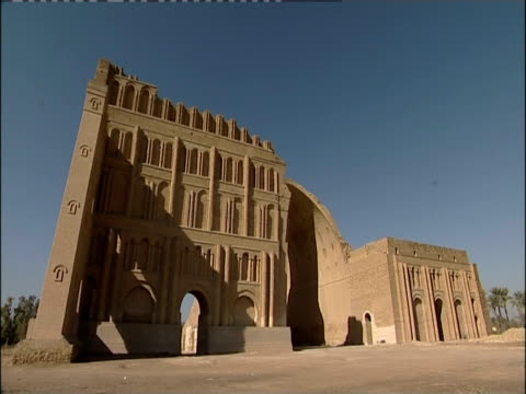 shadows fall across the taq-e kisra in the ancient city of ctesiphon. - mesopotamia stock videos and b-roll footage