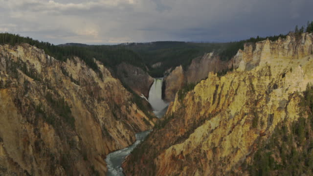 shadows fall over lower yellowstone falls in a time lapse of wyoming's grand canyon of the yellowstone. - lower yellowstone falls stock videos & royalty-free footage