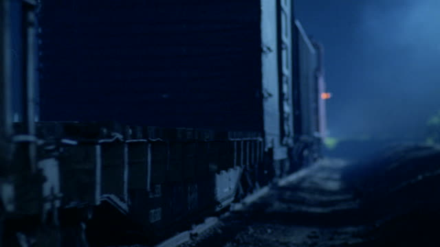 shadows falls across passing boxcars. - c119gs点の映像素材/bロール