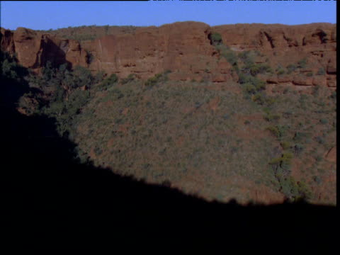 Shadows lengthen as night falls over Kings Canyon, Northern Territory, Australia