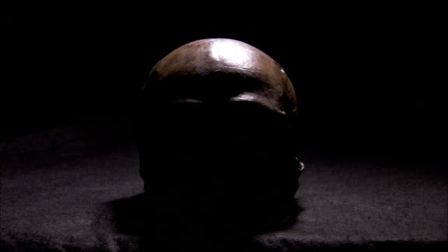shadows move across a human skull. available in hd. - skull stock videos and b-roll footage
