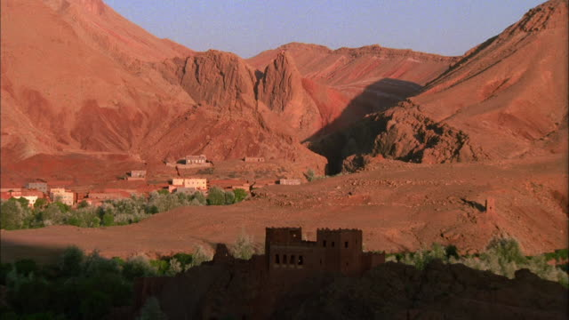 vidéos et rushes de shadows move across ancient ruins in the atlas mountains of morocco. available in hd. - maroc