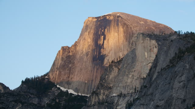 ms t/l shadows moving across half dome at yosemite national park / california, united states  - yosemite national park stock videos & royalty-free footage