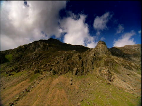 shadows of clouds cover snowdon peak wales - snowdonia stock videos & royalty-free footage