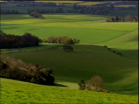 shadows of clouds rolling over south downs sussex - hügelkette stock-videos und b-roll-filmmaterial