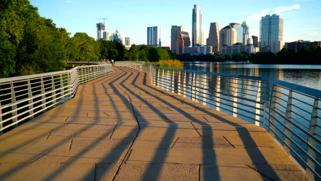 shadows of modern abstract view of the famous capital city - austin texas town lake reflection skyline cityscape - famous place stock videos & royalty-free footage