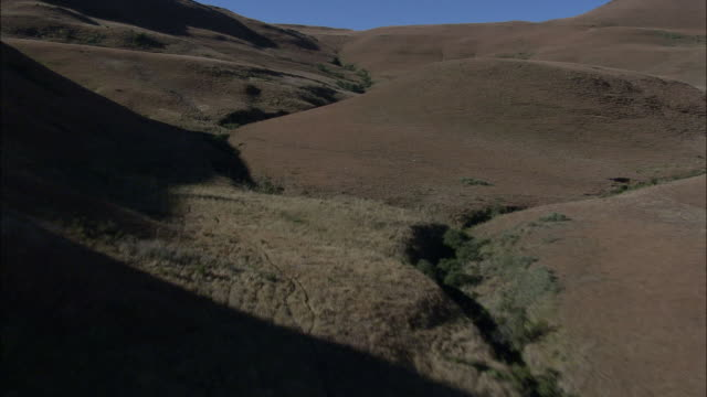 shadows of mountains in a valley in the drakensberg mountain range. available in hd - drakensberg mountain range stock videos & royalty-free footage