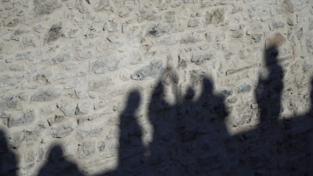 shadows of the people on stone wall - stone wall stock videos and b-roll footage