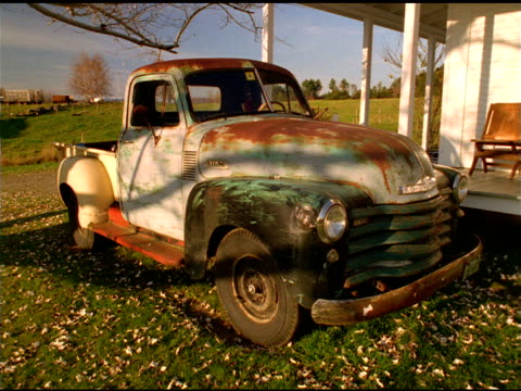 shadows pass over rusty pickup truck as days turns to night, waterbury, vermont - rusty stock videos & royalty-free footage
