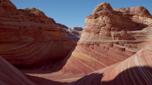 MS T/L Shadows reveal red clay rock formations in desert / Utah, United States