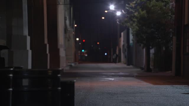 WS Shadowy figure walking in a dark alley / Los Angeles, California, United States