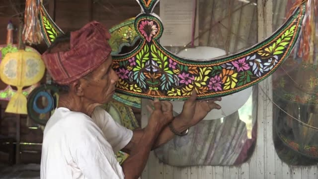 shafie jusoh loves traditional malaysian kites so much that he can't get a good night's rest unless he's been working on them daily - malaysia stock videos and b-roll footage
