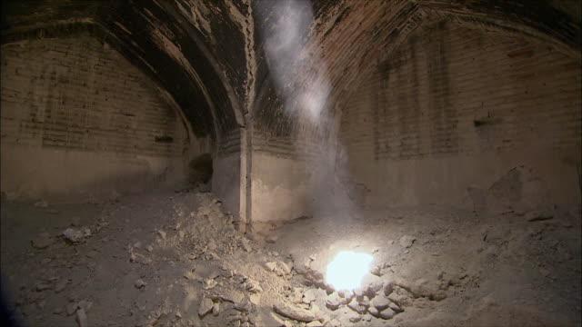 ws tu shaft of sunlight coming through hole in ceiling of caravanserai, iran - inn stock videos & royalty-free footage