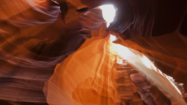 ms t/l td shafts of light falling on rock and shadows moving across rock formation / page, arizona, united states - page arizona stock videos and b-roll footage