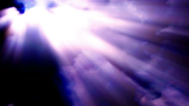 shafts of light stream through moving clouds in a dark sky. - digital enhancement stock videos & royalty-free footage