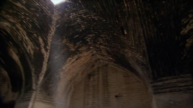 ws pan td shafts of sunlight coming through holes in ceiling of caravanserai, iran - inn stock videos & royalty-free footage