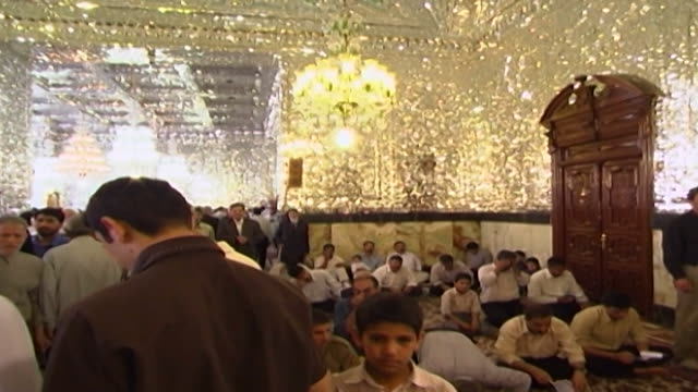 shah abdol azim shrine view of the gold glassmosaics decorating the interior pilgrims are visiting the shrine which contains the tomb of abdul adhim... - refraction stock videos & royalty-free footage