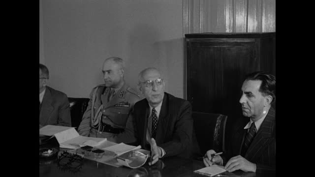shah appointed approved by parliament ext entrance gate to the majlis of iran / prime minister dr mohammed mossadegh sitting at table talking w/... - 1951 stock videos & royalty-free footage