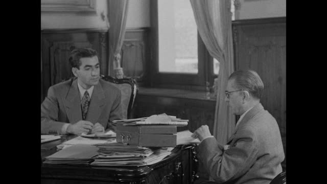 shah of iran in office with minister shah's palace large square building w/ mountains bg int office w/ shah of iran mohammad reza pahlavi meeting w/... - iran stock-videos und b-roll-filmmaterial