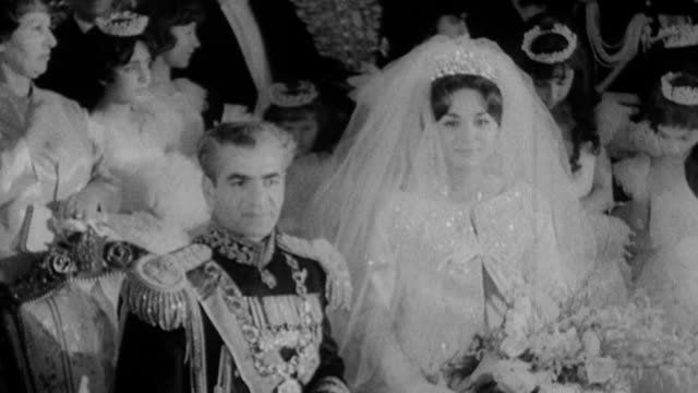 Shah of Iran Pahlevi marries his third wife Farah Diba / the couple at their wedding on December 21st the bride wearing a Yves St Laurent wedding...