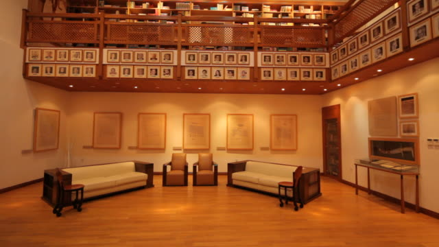 shaikh ebrahim bin mohammed al-khalifa center. tilt-down from the ceiling to the main entrance hall and library. - bookshelf stock videos & royalty-free footage
