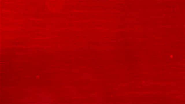 HD: Shake the red ink in a glass cup.