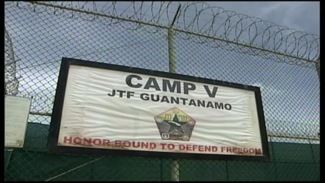 shaker aamer interview r12090610 / 1292006 guantanamo bay naval base camp delta ext sign on wire fence camp v jtf guantanamo honorbound to defend... - shaker aamer stock videos & royalty-free footage