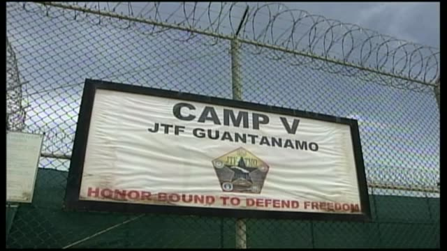 reactions r12090610 / cuba guantanamo bay naval base ext sign on wire fence camp v jtf guantanamo honorbound to defend freedom - shaker aamer stock videos & royalty-free footage