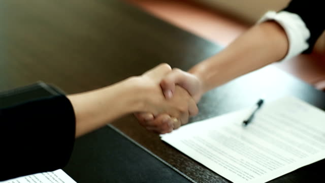 Shaking Hands After Signed papers