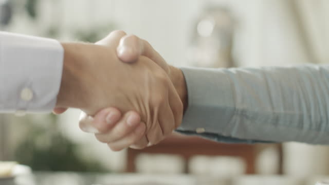 shaking hands - handshake stock videos and b-roll footage