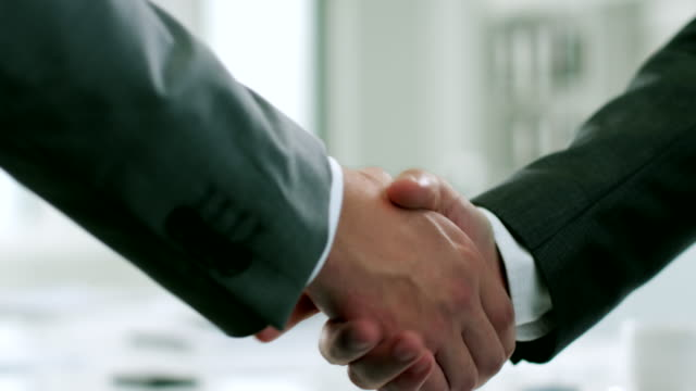 shaking hands - handshake stock videos & royalty-free footage