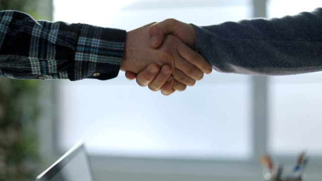shaking hands - trust stock videos & royalty-free footage