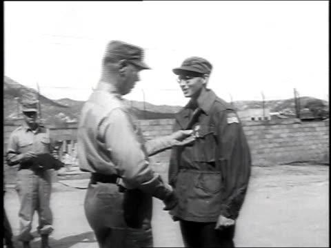 Shaking hands with General Van Fleet