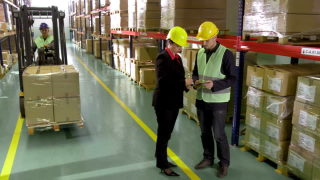 Shaking Hands With Warehouse Manager