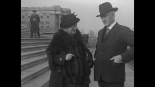 Shaky 2shot incoming US Congresswoman Alice Mary Robertson with her predecessor John Harreld on steps of the United States Capitol / closeup of...