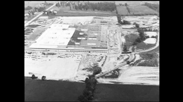 shaky aerial view of country landscape and construction site - 1940 1949 stock videos & royalty-free footage