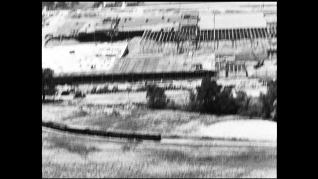 shaky aerial view of large industrial construction site - 1940 1949 video stock e b–roll
