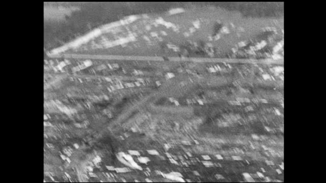 shaky aerial view of suburban landscape and large construction site with patches of snow - 1940 1949 video stock e b–roll