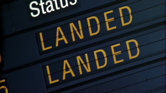 fast motion shaky airplane flight schedule board - arrival departure board stock videos & royalty-free footage
